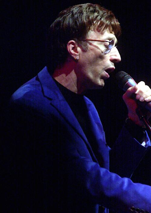 FILE - In this June 9, 2005, file photo, musician and former member of The Bee Gees Robin Gibb performs during a concert at Hong Kong's convention center. A representative said on Sunday, May 20, 2012, that Gibb has died at the age of 62. (AP Photo/Lo Sai Hung, File)