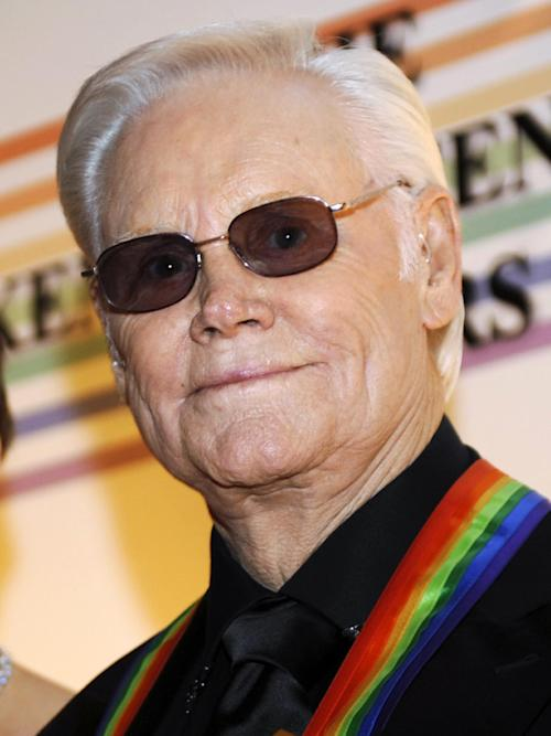 FILE - In this Dec. 7, 2008 file photo, George Jones arrives for the Kennedy Center Honors at the Kennedy Center in Washington. A Minnesota casino says legendary country singer George Jones is ill and has canceled a concert scheduled this week. Jones was scheduled to perform Friday, Nov. 2, 2012, at the Shooting Star Casino, Hotel and Event Center in Mahnomen, Minn. That concert had been rescheduled from April, when Jones needed more time to recover from an upper respiratory infection. (AP Photo/Jacquelyn Martin, File)