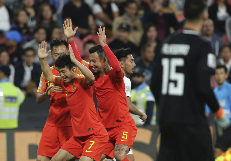 China's defender Wu Lei, center left, celebrates his opening goal with his teammates, during the AFC Asian Cup group C soccer match between China and Phillipines at Mohammed Bin Zayed Stadium in Abu Dhabi, United Arab Emirates, Friday, Jan. 11, 2019. (AP Photo/Kamran Jebreili)