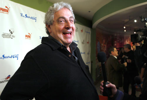 "FILE - In this Dec. 12, 2009 file photo, actor and director Harold Ramis laughs as he walks the Red Carpet to celebrate The Second City's 50th anniversary in Chicago. An attorney for Ramis said the actor died Monday morning, Feb. 24, 2014, from complications of autoimmune inflammatory disease. He was 69. Ramis is best known for his roles in the comedies ""Ghostbusters"" and ""Stripes."" AP Photo/Jim Prisching)"