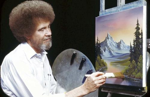"This undated image released by Copyright Bob Ross Inc./The Joy of Painting, shows the late Bob Ross, host of the PBS series ""The Joy of Painting."" PBS said Thursday it's posted a video remix with clips from ""The Joy of Painting"" instructional series, featuring the late Bob Ross. The ""Happy Painter"" remix is from John Boswell, who created the ""Garden of Your Mind"" video tribute to Fred Rogers. That mashup of clips from ""Mister Rogers' Neighborhood"" has been viewed nearly 6 million times on YouTube. ""The Joy of Painting,"" still seen in repeats, aired on PBS from 1983 to 1994 with its bushy-haired, mellow-voiced host. Ross died in 1995. (AP Photo/Copyright Bob Ross Inc. ® The Joy of Painting)"