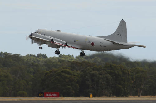 A Japan Maritime Self-Defense Force P-3C Orion takes off from the Royal Australian Air Force Pearce Base to commence a search for possible debris from the missing Malaysia Airlines flight MH370, in Perth, Australia, Monday, March 24, 2014. Satellite images released by Australia and China had earlier identified possible debris in an area that may be linked to the disappearance of the flight on March 8 with 239 people aboard. (AP Photo/Paul Kane, Pool)