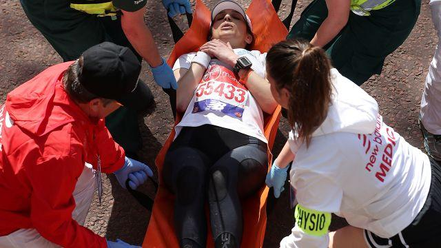 Some runners had to be taken away on stretchers. Image: AFP