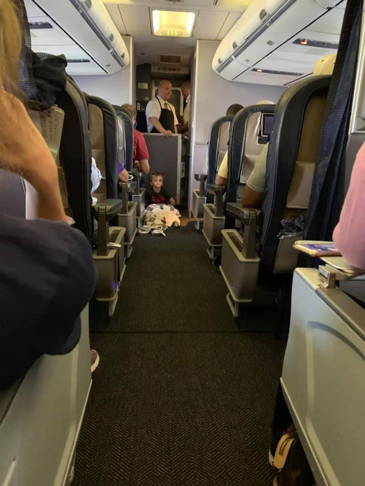 Braysen spent most of the flight on the floor where he could feel the vibrations of the plane and felt comfortable. Source: Lori Gabriel