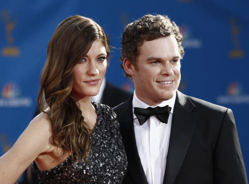 FILE - In this Aug. 29, 2010 file photo, Michael C. Hall arrives with wife and co-star Jennifer Carpenter for the 62nd Primetime Emmy Awards in Los Angeles. Court records show a judge finalized Carpenter and Hall's divorce on Friday, Dec. 2, 2011, in Los Angeles. The pair were married in December 2008. (AP Photo/Matt Sayles, File)