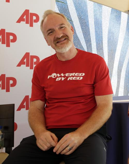 FILE- In this Saturday, Feb. 26, 2011 file photo celebrity chef Art Smith discusses a healthy journey to wellness during an interview with the Associated Press at the South Beach Wine and Food Festival in Miami Beach, Fla. Smith was diagnosed with Type 2 diabetes about three years ago. Smith ballooned to 325 pounds until he decided to turn it all around and lose 118 pounds. Now 51, the Jasper, Fla., native, restaurant owner, cookbook writer and food TV personality has kept the weight off. (AP Photo/J Pat Carter, FILE)