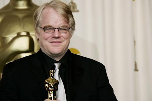 """FILE - In a Sunday, March 5, 2006, file photo, actor Philip Seymour Hoffman poses with the Oscar he won for best actor for his work in """"Capote"""" at the 78th Academy Awards, in Los Angeles. Police say Hoffman has been found dead in his apartment. Sunday Feb. 2014. HE WAS 46.(AP Photo/Kevork Djansezian, File)"""