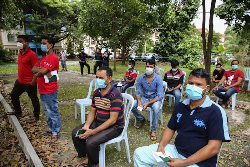 Foreign workers wait to be screened for Covid-19 in Taman Langat Murni, Kuala Langat June 4, 2020. — Picture by Yusof Mat Isa