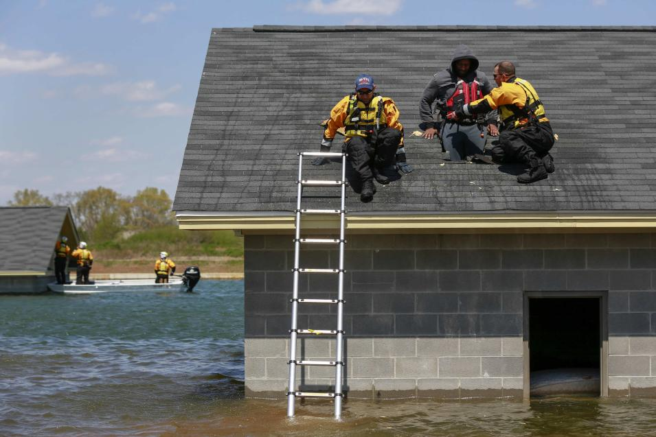 Rescue specialists for USA-1 rescue a victim from the scene of a flooded mock disaster area during a training exercise at the Guardian Center in Perry