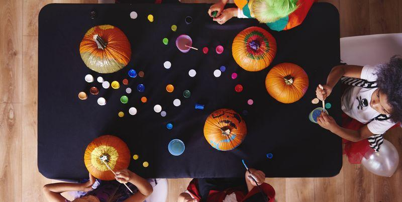 "<p>If only a few hours of trick-or-treating, bucketloads of Halloween candy, and <a href=""https://www.countryliving.com/diy-crafts/g1360/halloween-costumes-for-kids/"" target=""_blank"">halloween costumes for kids</a> were enough to keep your little monsters entertained on Halloween! <em>Sigh</em>—is that really too much to ask? Fear not, parents—we're here to help. We've rounded up some scary-good DIY Halloween games for kids to get ghouls of all ages in the party spirit and make this October 31 even more special, even if it looks a little different this year. Your celebrations will likely be a bit scaled down this year, but even if you're only entertaining your own kids (or if you're donning <a href=""https://www.countryliving.com/shopping/g32908775/coronavirus-halloween-fabric-face-mask/"" target=""_blank"">coronavirus Halloween face masks</a> for a socially distant party), there's still time for fun.</p><p>Before you don your best <a href=""https://www.countryliving.com/diy-crafts/g29074815/family-halloween-costume-ideas/"" target=""_blank"">family halloween costume ideas</a>, why not set up a quick round of pumpkin bowling in the backyard? You could even host a traditional skeleton scavenger hunt—or plan a quick ""ghost race"" around the block. Even a faux spider relay race doesn't take long to assemble. Some of the games will double as classic <a href=""https://www.countryliving.com/diy-crafts/g1370/outdoor-halloween-decorations/"" target=""_blank"">outdoor halloween decorations</a>.</p><p>If it's too cold to play outside or you're hosting a Halloween bash, you can have just as much fun indoors with DIY Halloween Twister, a pumpkin decorating contest, candy-filled pumpkin balloons that double  as piñatas, or a spook-tacular round of pin the spider on the web. Some games tap into your little ones' analytical thinking skills, others can inspire some friendly competition, and the rest are just downright silly ways to pass the time and make everyone smile. If anything, you can definitely count on these handmade activities to help your candy-loaded kids burn off their Halloween treats before bedtime!<br></p>"