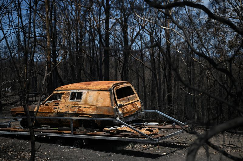 A burnt car destroyed in the recent bushfires is pictured in Conjola Park