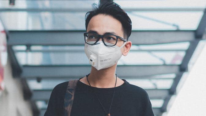 Ilustrasi pakai masker. (dok. Unsplash.com/@duongdaihiep123)