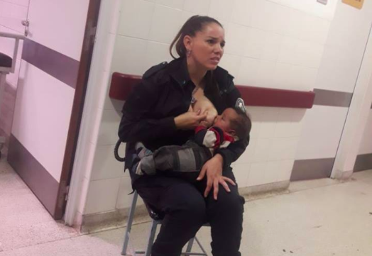 Buenos Aires police officer Celeste Ayala pictured breastfeeding a stranger's neglected baby. Source: Facebook/Marcos Heredia