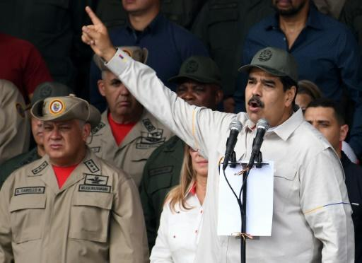 Diosdado Cabello (L) is the Venezuelan regime's second most powerful figure after President Nicolas Maduro (R)