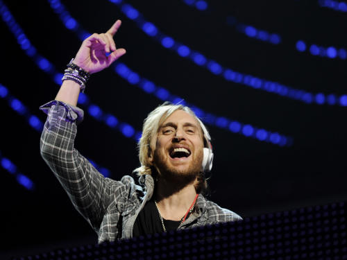 FILE - In this Dec. 9, 2011 file photo, DJ David Guetta performs at Z100's Jingle Ball concert at Madison Square Garden in New York. For the first time, the Grammy show will put the spotlight on the genre with a segment featuring Grammy nominees Deadmau5, the Foo Fighters, Chris Brown, David Guetta and Lil Wayne, all performing in a tent space amid 1,000 fans. (AP Photo/Evan Agostini, file)