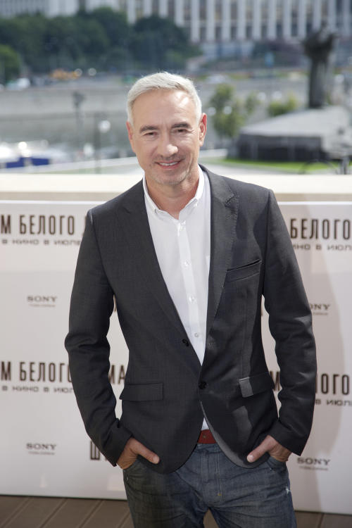 FILE - In this July 3, 2013 file photo, film director Roland Emmerich poses for photographers in Moscow, Russia. Although Hollywood may be benefiting by adding Chinese elements to its films, it won't be making wholesale changes to the way it tells stories on the screen just to cater to China's massive audience, the director said Wednesday, July 17, 2013. (AP Photo/Ivan Sekretarev, File)