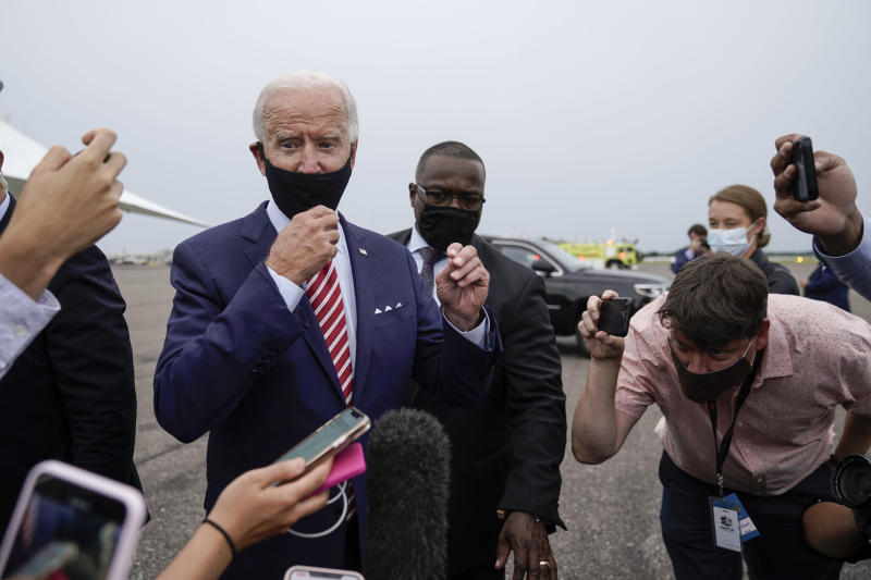 Democratic presidential nominee Joe Biden briefly speaks to reporters Tuesday before boarding his plane at Tampa International Airport. (Drew Angerer/Getty Images)