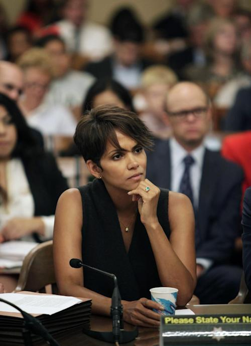 Actress Halle Berry listens to questions as she testifies before the Assembly Committee on Public Safety for a bill that would limit the ability of paparazzi to photograph children of celebrities and public figures, on Tuesday, June 25, 2013 at the Capitol in Sacramento, Calif. (AP Photo/Steve Yeater)