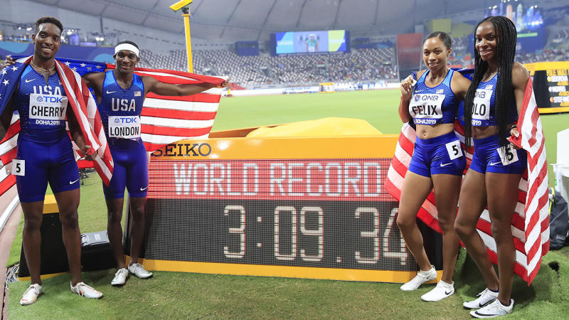 Wilbert London, Michael Cherry, Courtney Okolo and Allyson Felix, pictured here with their new world record.