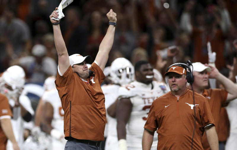 Texas coach Tom Herman celebrates a touchdown during the second half against Georgia in the Sugar Bowl NCAA college football game Tuesday, Jan. 1, 2019, in New Orleans. (AP Photo/Rusty Costanza)