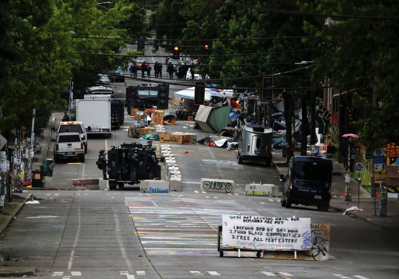 Seattle police clear protest zone after flares of violence