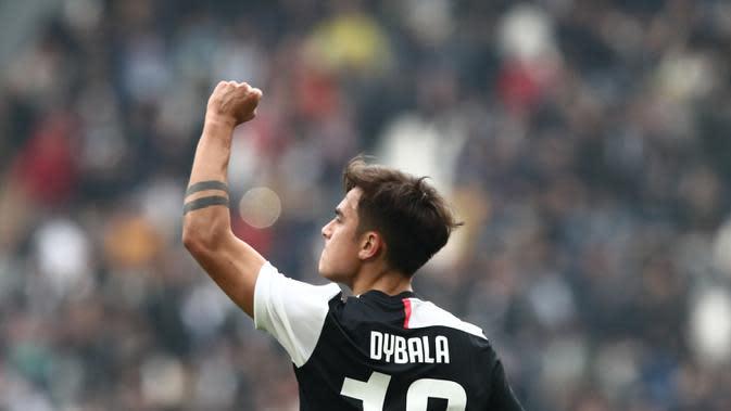 Pemain Juventus Paulo Dybala melakukan selebrasi usai mencetak gol ke gawang Brescia pada pertandingan Serie A di Turin, Italia, 16 Februari 2020. Meski terjangkit virus corona COVID-19, Dybala dilaporkan baik-baik saja dan tidak menunjukkan gejala. (Isabella BONOTTO/AFP)