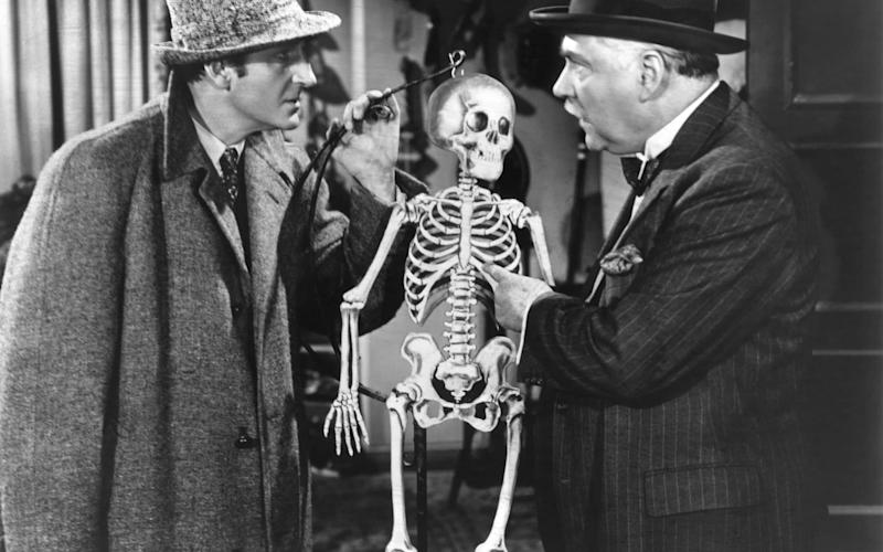 Chemistry: Basil Rathbone and Nigel Bruce as Holmes and Watson - Corbis Historical