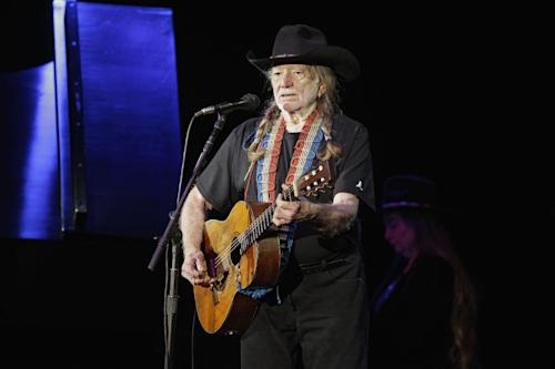 FILE - In this Sunday, Jan. 29, 2012 file photo, country music icon Willie Nelson performs during a fundraising concert for U.S. Rep. Dennis Kucinich in Lorain, Ohio. Willie Nelson, Jamey Johnson, Band of Horses and actor-musician John Reilly and Friends, are all on board for this year's Railroad Revival Tour. The train tour kicks-off Oct. 20 in Duluth, Ga., and runs through Oct. 28 in Oakland, Calif. (AP Photo/Mark Duncan, File)