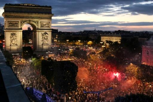 Fans in Paris celebrate France's victory against Belgium in the World Cup semi-finals
