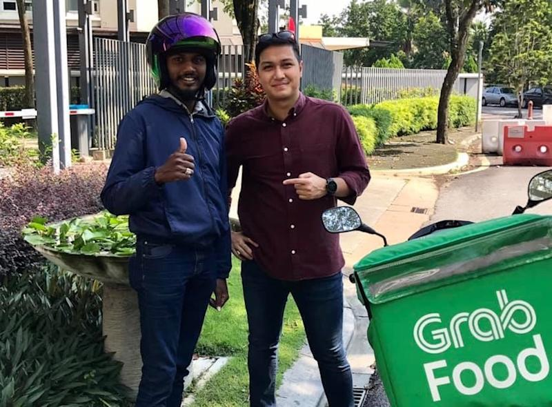 Ganesh (left) said that he was extremely grateful to Aiman (right) for lending him a helping hand. — Picture via Facebook/Aiman Manan.