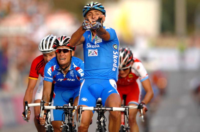 Cycling : WC Road Stuttgart / Men Elite Arrival / BETTINI Paolo (Ita) Celebration Joie Vreugde / KOLOBNEV Alexandr (RUS) / SCHUMACHER Stefan (GER) / SCHLECK Frank (LUX) / UCI Road World Championships / Championat du Monde Route / Wereldkampioenschap Weg / (c)Tim De Waele