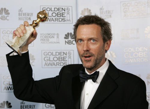 "FILE - In this Jan. 15, 2007 file photo, actor Hugh Laurie poses with the award he won for best actor in a drama series for his work on ""House,"" at the 64th Annual Golden Globe Awards in Beverly Hills, Calif. The Fox medical drama concludes its eight-season run on Monday, May 21, 2012, with a finale at 9 p.m. EDT, preceded by a one-hour retrospective. (AP Photo/Kevork Djansezian, file)"