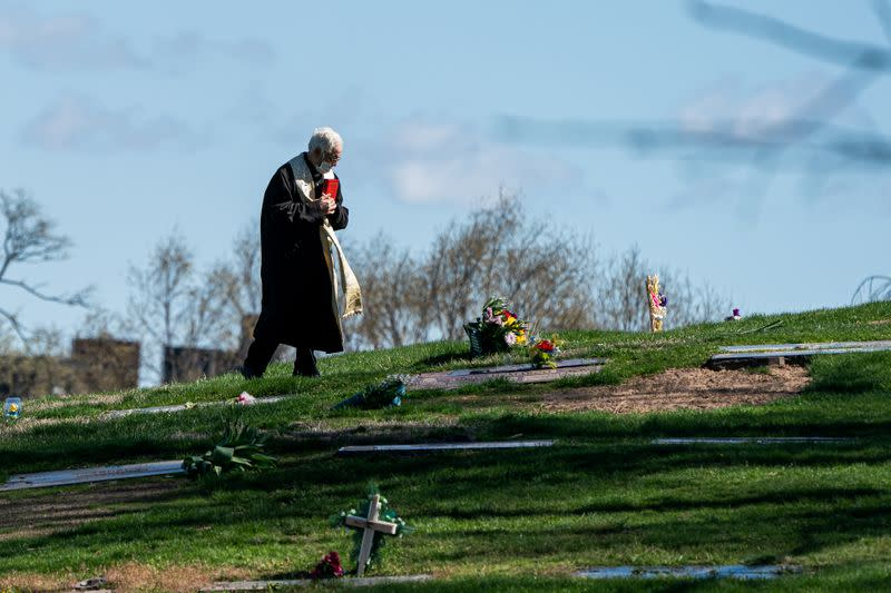 A pastor wearing a protective mask is seen at The Green-Wood Cemetery during the outbreak of the coronavirus disease (COVID-19) in the Brooklyn borough of New York City