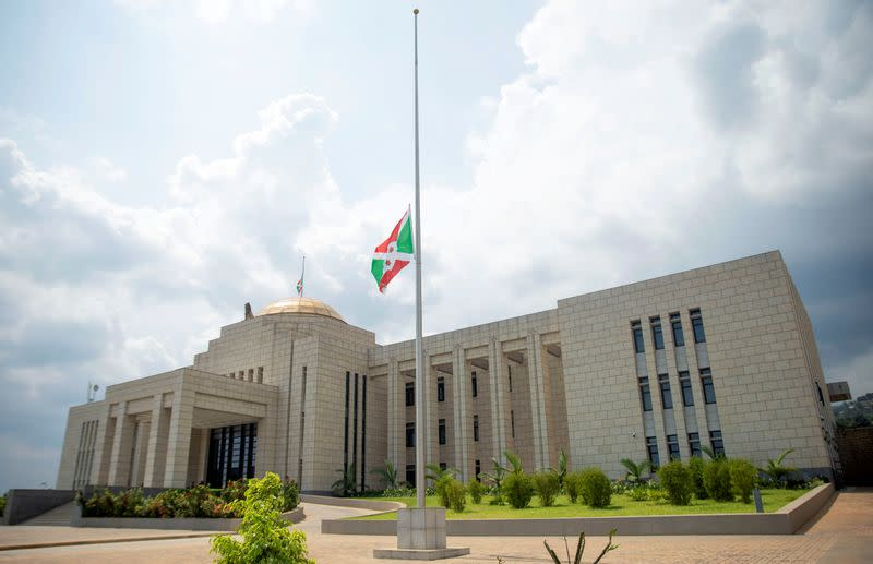 FILE PHOTO: The Burundian national flag flies at half mast outside the State House building following the death of Burundi's President Pierre Nkurunziza, in Bujumbura