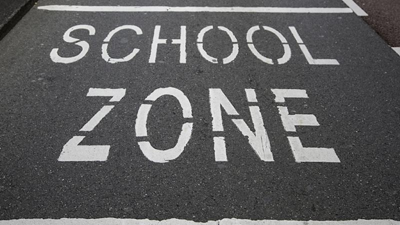 A school zone marked out on the road.