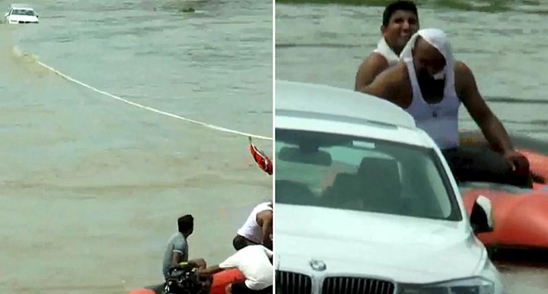 A group of men on a raft work to pull a BMW from Yamunanagar in India's north. The man who owns it received it as a birthday present from his parents. He then allegedly pushed it into the river because he wanted a Jaguar.