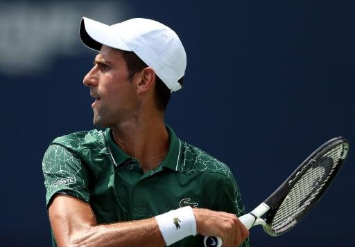 Novak Djokovic double-faulted while serving for his match against Mirza Basic, slipping into a second-set tie-break, but he finished the job for a second-round spot