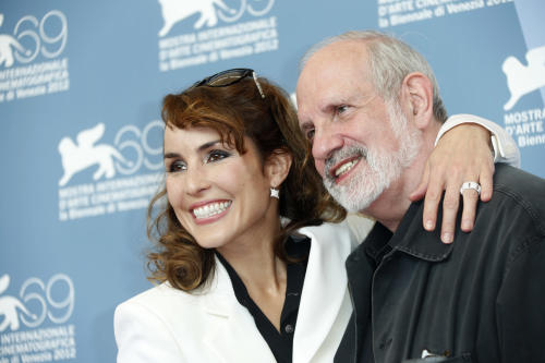 Actress Noomi Rapace and director Brian De Palma at the photo call of the film 'Passion' at the 69th edition of the Venice Film Festival in Venice, Italy, Friday, Sept. 7, 2012. (AP Photo/Andrew Medichini)