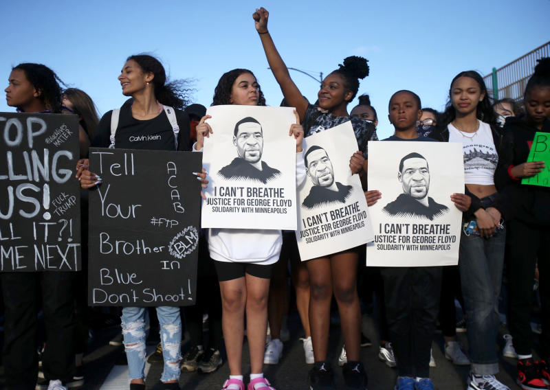 Marchers move west on Burnside towards the Burnside Bridge in Portland, Tuesday evening, June 2, 2020.  Protests continued for a sixth night in Portland, demonstrating against the death of George Floyd, a black man who died in police custody on Memorial Day in Minneapolis. (Sean Meagher/The Oregonian via AP)