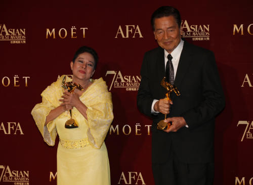 "The Philippines actress Nora Aunor, left and Philippines actor Eddie Garcia pose with their trophies after winning the Best Actress Award of her movie ""Thy Womb"" and Best Actor Award of his movie ""Bwakaw"" at the Asian Film Awards as part of the 37th Hong Kong International Film Festival in Hong Kong Monday, March. 18, 2013. (AP Photo/Kin Cheung)"