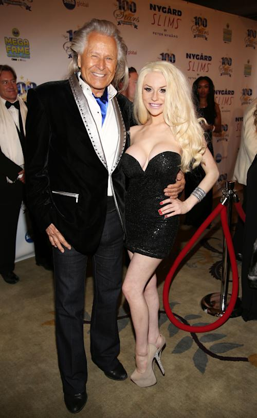 Peter Nygard, left, and Courtney Stodden arrive at the 24th Night of 100 Stars Oscars Viewing Gala at The Beverly Hills Hotel on Sunday, March 2, 2014 in Beverly Hills, Calif. (Photo by Annie I. Bang /Invision/AP)