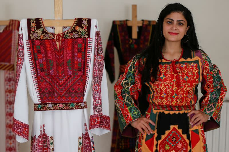 A model presents traditional Palestinian dresses at Al Hanouneh society for popular culture in Amman