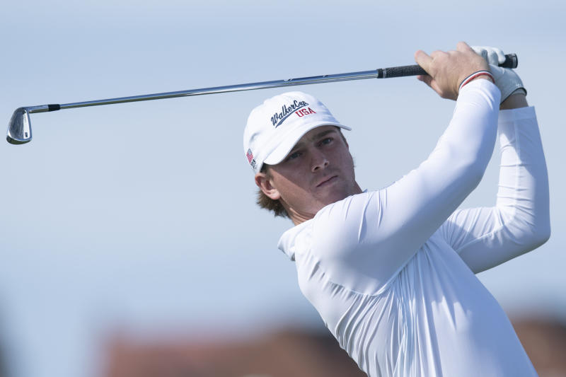 FILE - In this Sept. 8, 2019, file photo, John Augenstein of the USA team drives off the second tee during the Walker Cup golf tournament against Great Britain and Ireland at Royal Liverpool Golf Club in Hoylake, England. Augenstein is returning to Vanderbilt for a fifth season of eligibility because of the COVID-19 pandemic. (AP Photo/Jon Super, File)