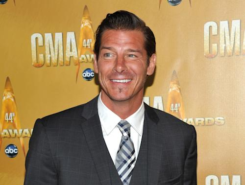 "FILE - This Nov. 10, 2010 file photo shows TV personality Ty Pennington at the 44th Annual Country Music Awards in Nashville, Tenn. HLN said Wednesday, Jan. 2, 2013, that Pennington, who stars in ""Extreme Makeover: Home Edition,"" will host a monthly series called ""American Journey."" It will focus on people with unusual lifestyles, and debuts Saturday, Jan. 12. Each episode will air multiple times over the weekend on the network formerly known as CNN Headline News, with a new edition starting each month. (AP Photo/Evan Agostini, file)"