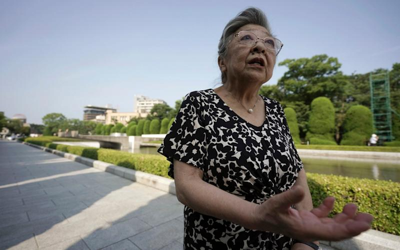 Koko Kondo gives an interview in which she spoke of her determination to find the crew of the Enola Gay - Eugene Hoshiko /AP
