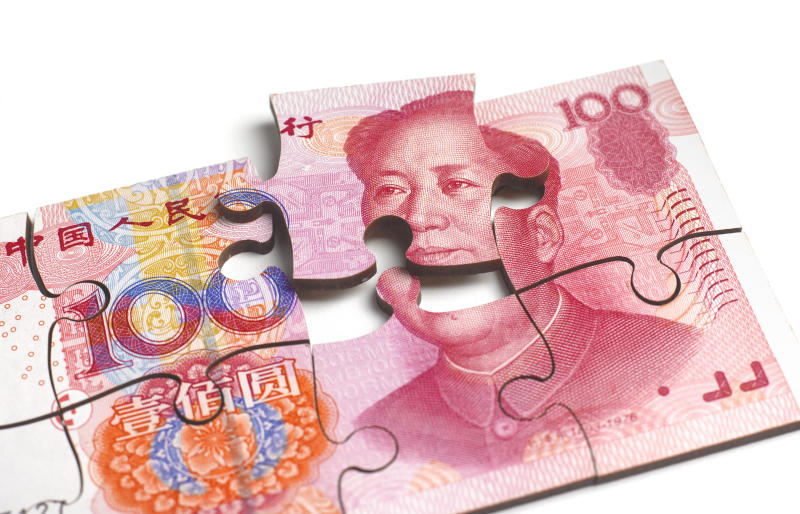 CHINESE 100 YUAN NOTE IN SHAPE OF JIGSAW PUZZLE FALLING APART