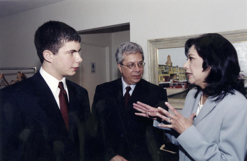 In this May 22, 2000 photo provided by the John F. Kennedy Library Foundation, Pete Buttigieg, the 2000 Profile in Courage Essay Contest Winner and his father Joseph Buttigieg, center, talk with Hilda Solis, 2000 Profile in Courage Award Winner at the John F. Kennedy Presidential Library and Museum in Boston. (Joey Libby/John F. Kennedy Library Foundation via AP)