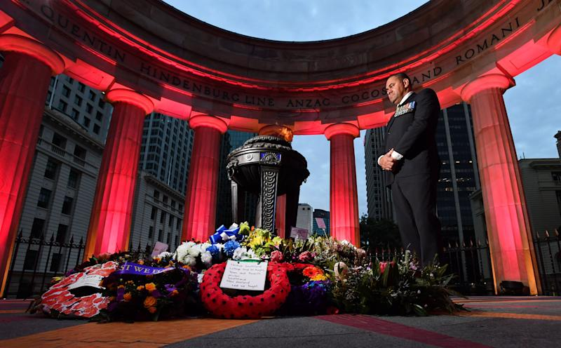 Australian Army veteran Peter Rabula is seen posing for a photograph after the Anzac Day dawn service at the Shrine of Remembrance in Anzac Square in Brisbane. Source: AAP