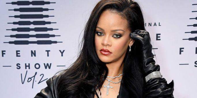Here's Rihanna Looking Amazing in a Sheer Bra, Leather Blazer, Fishnets, and No Pants
