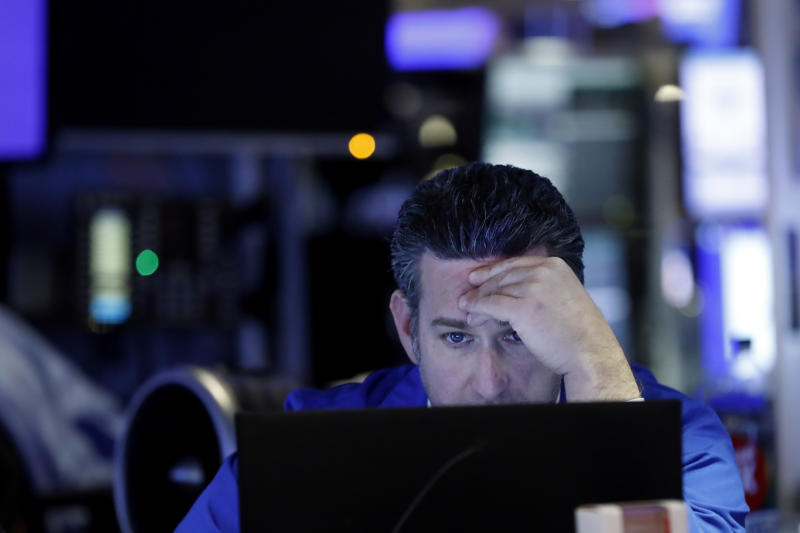 Trader Glenn Kessler works on the floor of the New York Stock Exchange, Tuesday, Feb. 18, 2020. U.S. stocks slipped in early trading Tuesday after technology giant Apple became the most well-known company to warn of a financial hit from the virus outbreak in China. (AP Photo/Richard Drew)